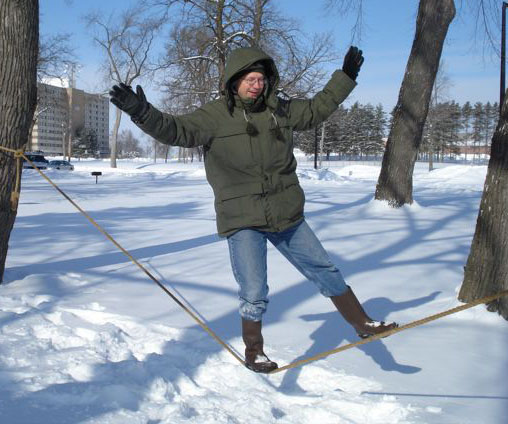 Picture of Steven Sahyun rope 	walking in winter.